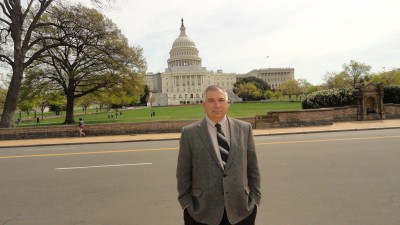 Stan Schultz, owner and founder of SSE, standing in front of the Capitol in Washington, D.C.